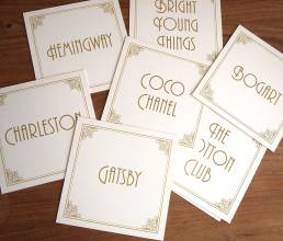 Table name cards featuring names from the Art Deco era