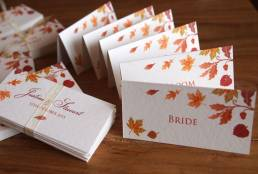 A group of Autumn wedding place name tent cards