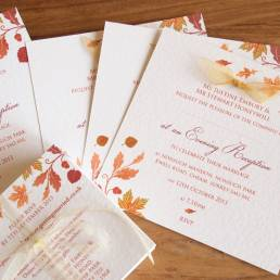 An autumn wedding invitation set finished with ribbons