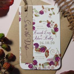 An autumn wedding invitation with a blackberry illustration and a rustic save the date tag
