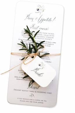 Italian style wedding menu tied with sprig of rosemary