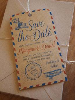 an airmail style save the date on rustic kraft paper