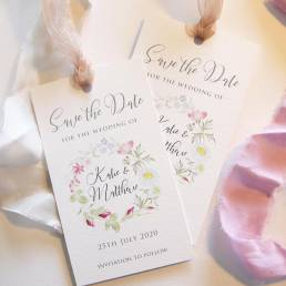 save the date tags with a wildflower group
