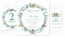 A Christmas wedding invitation with a botanical wreath design