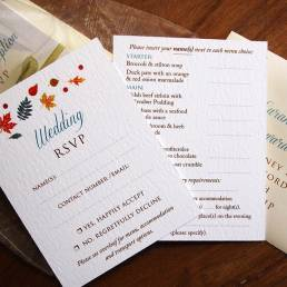 falling leaves wedding reply card with menu choices on the reverse