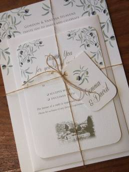 A invitation bundle with rsvp and envelope for a wedding abroad on the Italian Lakes