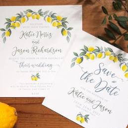 An invitation and save the date in a design of lemons and leaves for a wedding abroad