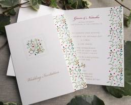 christmas wedding invitations in a booklet design with a mistletoe graphics
