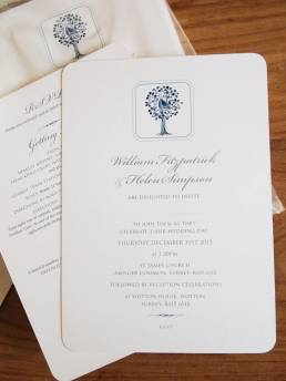 A winter wedding invitation featuring a partridge in a pear tree design